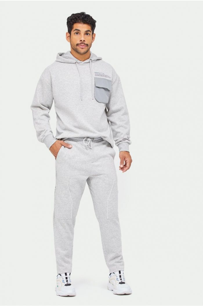 Sweatpants with lining details and zipper pockets on legs